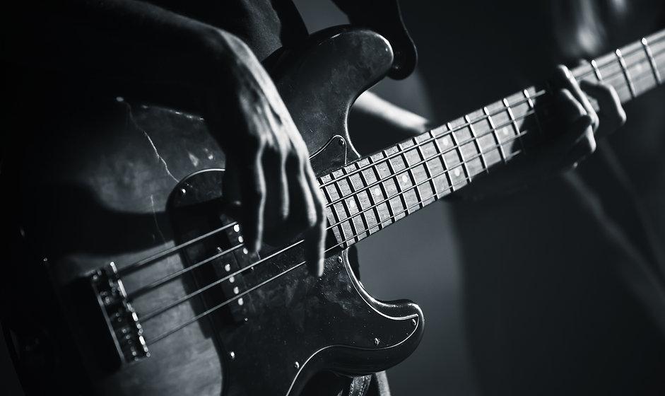 Electric bass guitar player hands, live