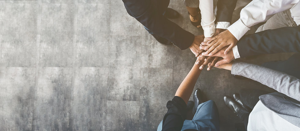 Unity and teamwork. Business people putting their hands together, top view, copy space.jpg