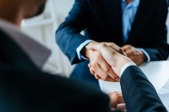 Partnership. two business people shaking hand after business job interview in meeting room