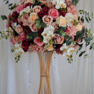 Ultimate luxorious mixed floral arrangement on a gorgeous gold stand