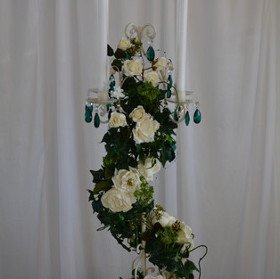 white candelabra wth ivory green garland
