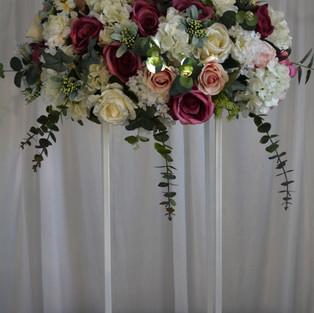 Elegant floral mix arrangement on a ivory rectangle plinth