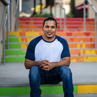 Young Man sitting on steps.
