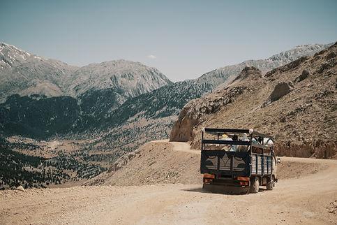 truck-driving-mountain-road.jpg