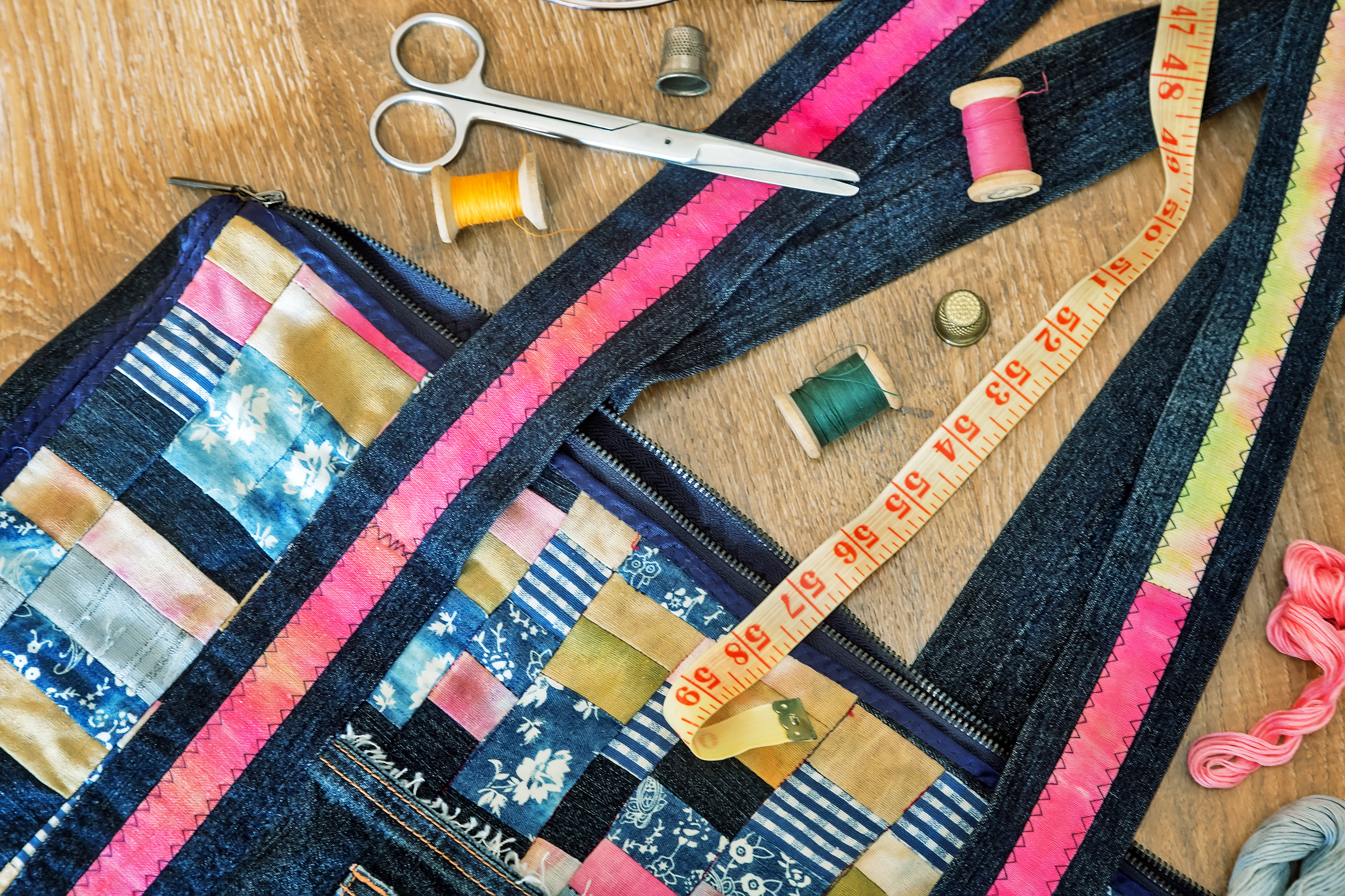 Beautiful female bag of colorful scraps of fabric in patchwork.jpg Handmade.jpg Next are the threads