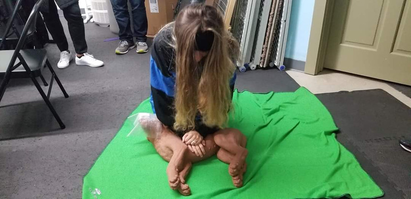 Callie performs CPR on dog mannequin