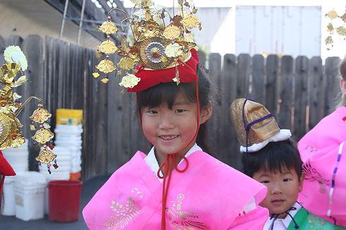 Child in celebratory clothing