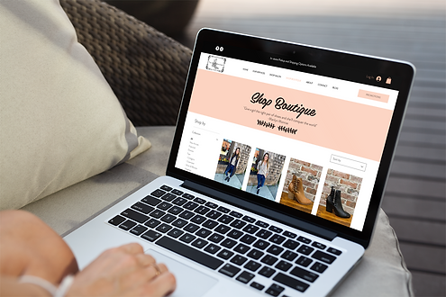 Laptop with The Style Merchant website displayed