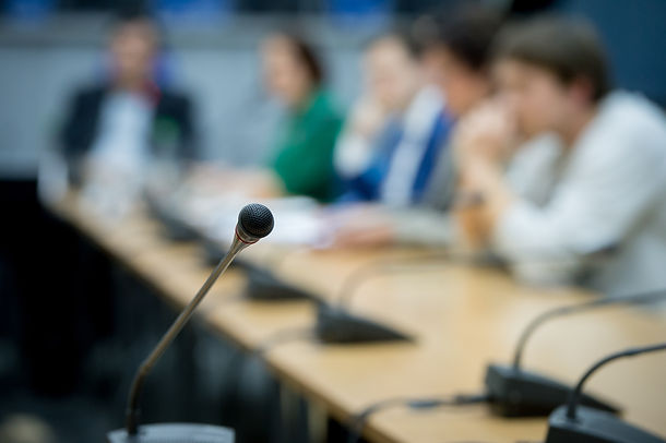 Press conference. Microphone in seminar room conference event. Abstract blurred background