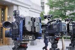 video cameras poised outside of a courthouse - Primestar Digital
