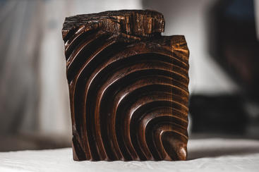 """""""Tactus"""" - By Levi Smith Partial fingerprintwood sculpture,hand-carved fromreclaimed black walnut.  10.'' H x 8.'' W x 2.'' D"""