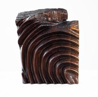 Partial fingerprint wood sculpture, hand-carved from reclaimed black walnut.    10.'' H x 8.'' W x 2.'' D
