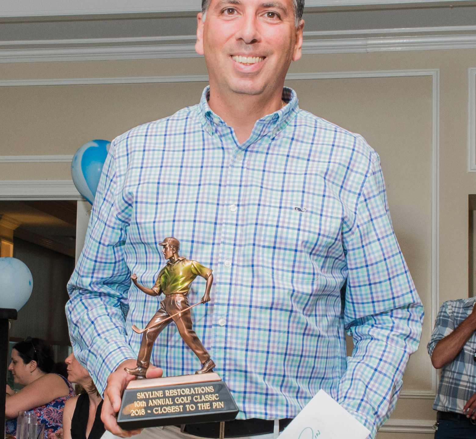 Peter Gerazounis, P.E., with MGE Engineering, accepts award for closest to the pin at Skyline's 10th Annual Charitable Golf Classic.