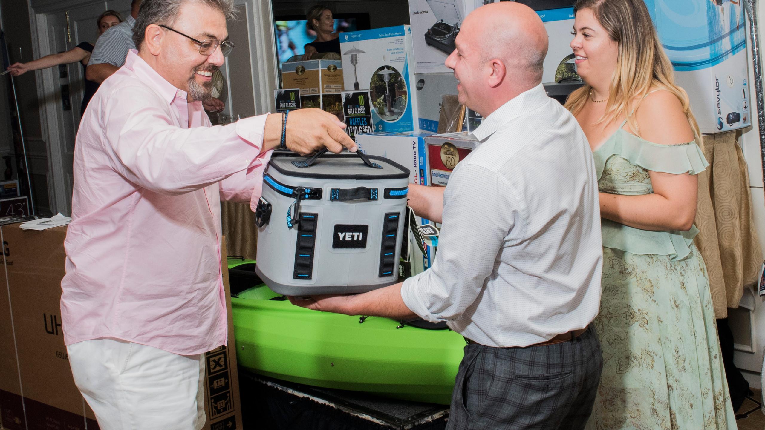 John Tsampas (left), President of Skyline, presents gift to CANY's Thomas Seminara (right).