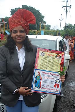 Madam with Award.png