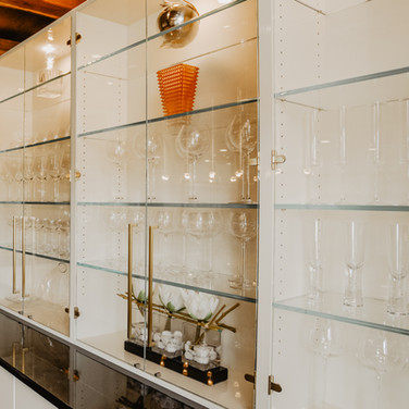 Custom Cabinet with glass shelves and doors