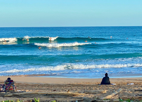 Surfers at Kealia Beach