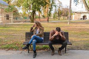 woman-and-man-sitting-on-brown-wooden-be