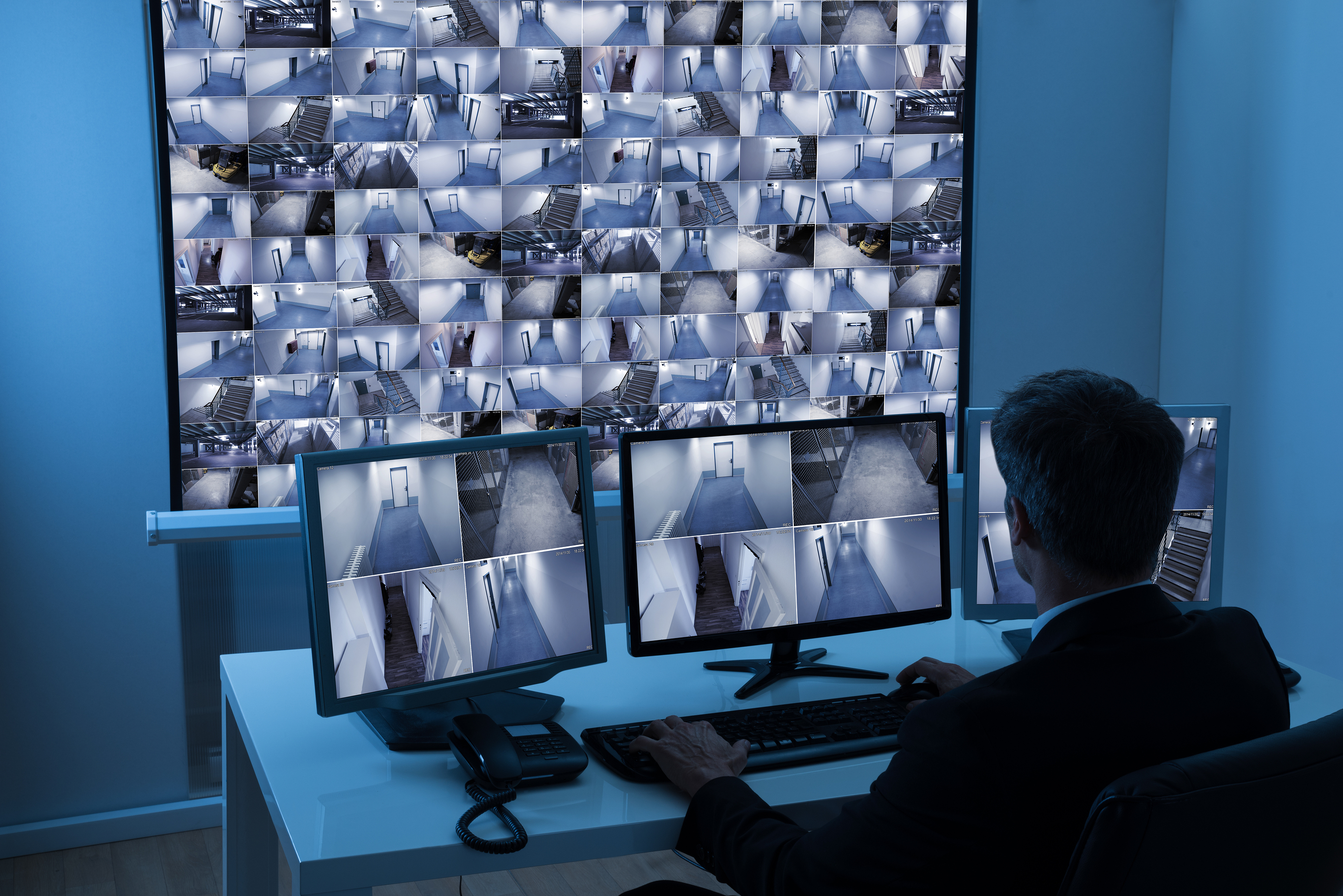 Man In Control Room Monitoring Cctv Footage.jpg