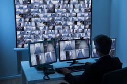 Man In Control Room Monitoring Cctv Footage.jpg