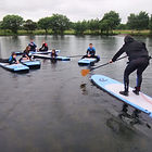 learning to standup paddle board, strathyre, scotland
