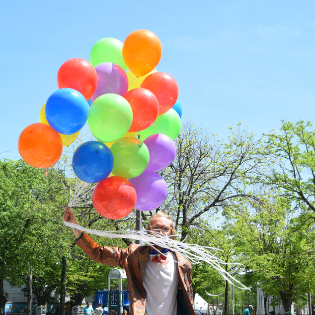 Person with balloons