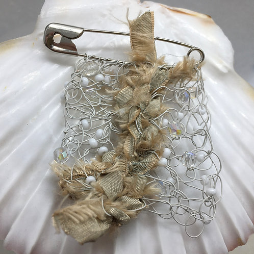 Knitted ivory pin brooch