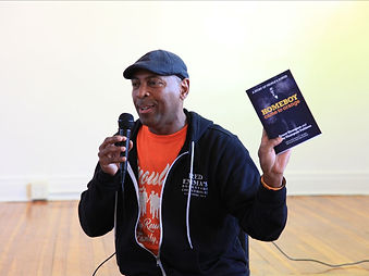 Dominic Moulden holding copy of Homeboy Came to Orange