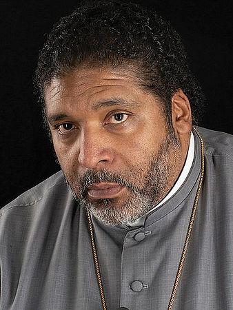 A color portrait of Reverend Barber.