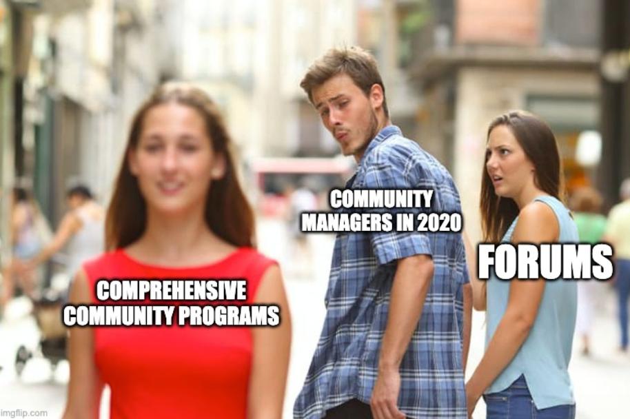 "meme of man holding hand with woman and looking over shoulder at another woman. Man labeled ""community managers in 2020."" Woman 1 labeled ""forums."" Woman 2 labeled ""comprehensive community programs."""