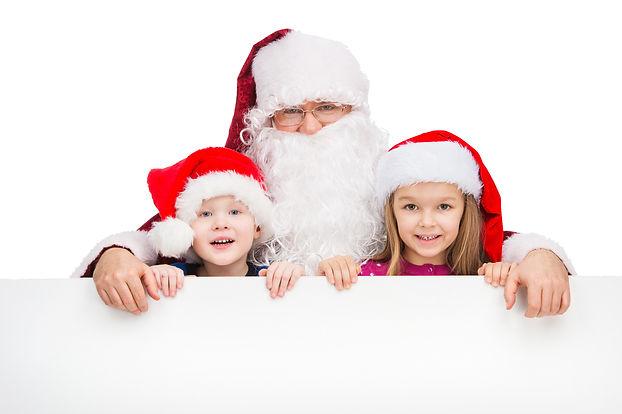 Old classic Santa Claus hugging two litt