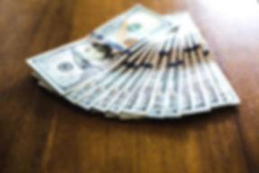 fanned-hundred-dollar-bills_925x.jpg