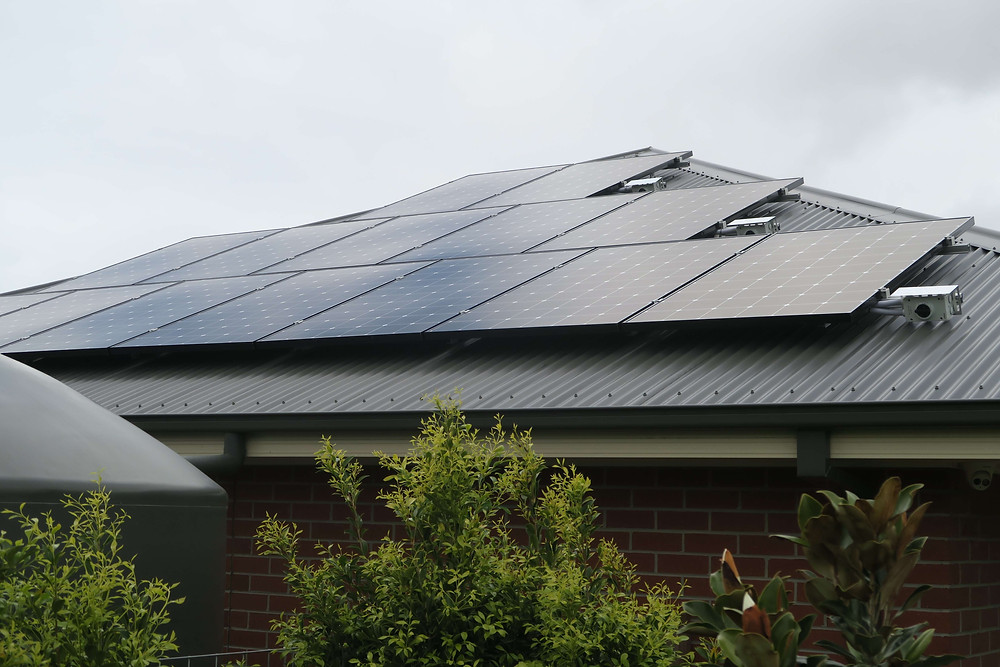 Note the Triangular design of the solar panels to blend into roof line