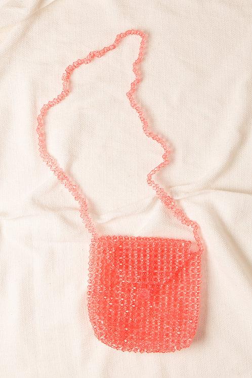 Bolsa de cristais rosa