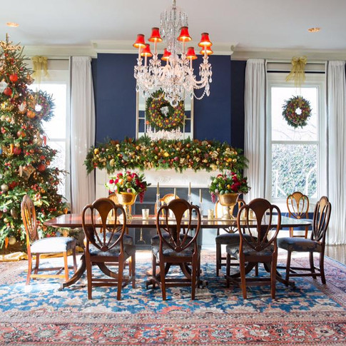 Christmas dining room installation, tree, wreaths, table and mantle