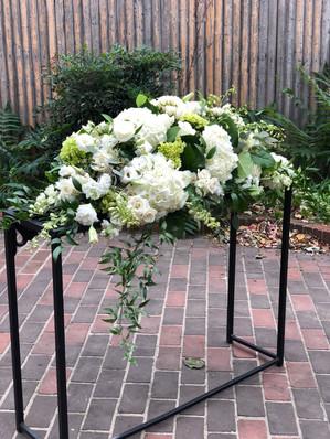 white sympathy arrangement for table