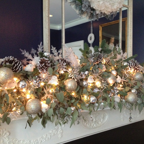 Eucalyptus fireplace Christmas garland with silver ornaments, silver dipped pinecones and lights