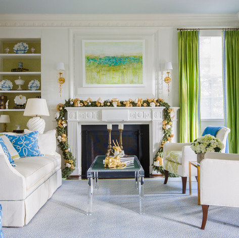 Christmas mantle decor with gold ornaments and bows