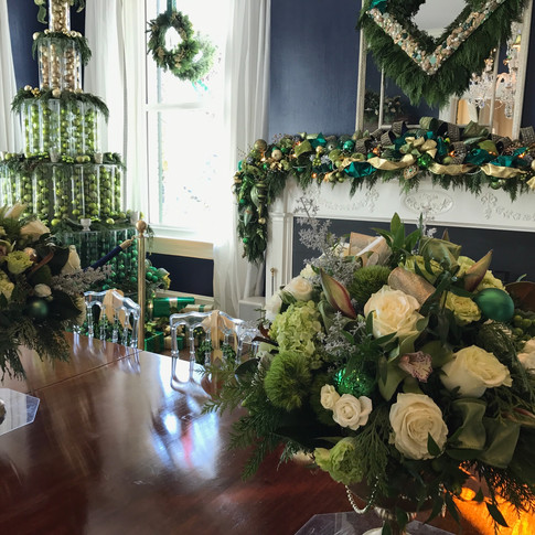 Christmas dining room installation, ornament tree, wreaths, table and mantle