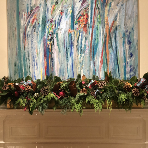 Christmas fireplace garland with evergreens, magnolia leaves and seed pods