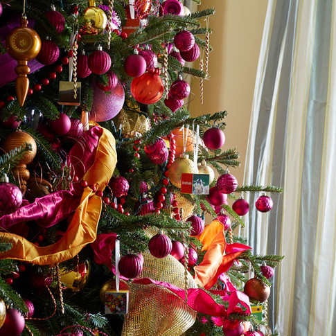 Hot pink fuschia, orange and gold Christmas tree with ribbon garland; from VP Biden's home