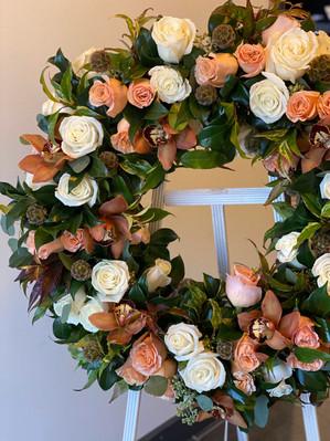 Peach and white funeral wreath
