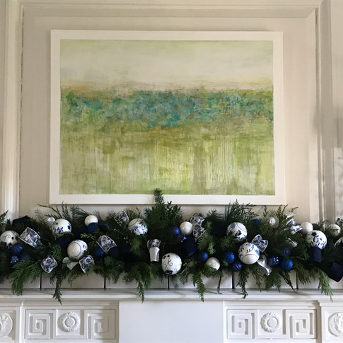 Blue and white mantle decor with ornaments and ribbon loops