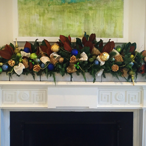 Blue and gold Christmas mantle garland with magnolia leaves