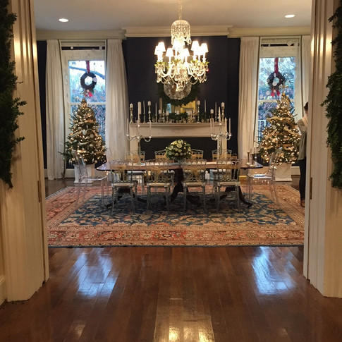 White and gold dining room Christmas decor with miniature trees, candelabras, and mantle decor