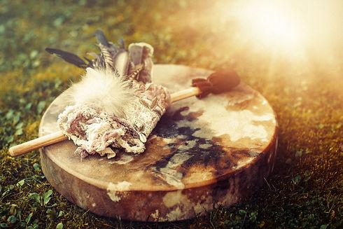 shamanic drum and shamanic feathers on d