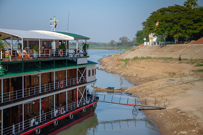 River cruise ship on the banks of the Ir