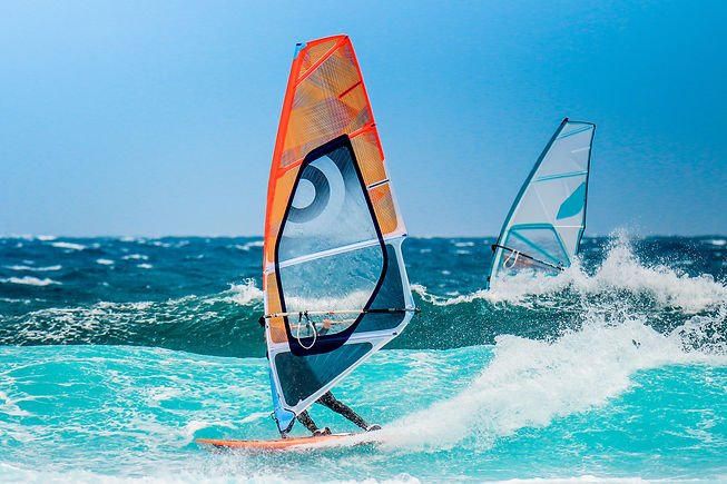 water sports: windsurfers with colored s