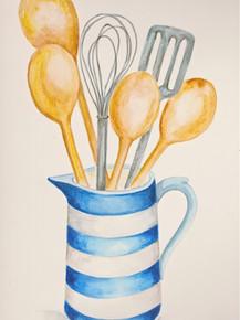 Kitchen utensils in blue and white jug.