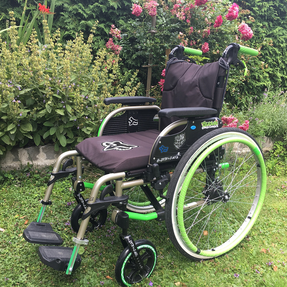 My first wheelchair, with some modifications